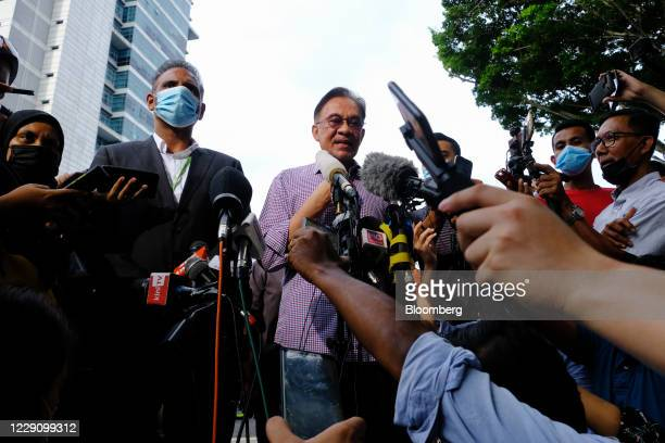 Anwar Ibrahim founder and president of the People's Justice Party speaks to members of the media during a news conference outside the Bukit Aman...