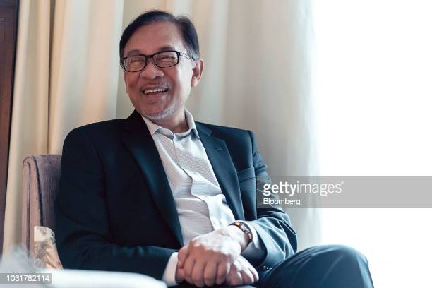 Anwar Ibrahim founder of Malaysia's People's Justice Party laughs during an interview in Hong Kong China on Wednesday Sept 12 2018 Anwar whos in line...