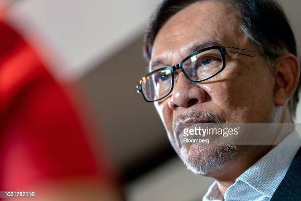 Anwar Ibrahim founder of Malaysia's People's Justice Party listens during a Bloomberg Television interview in Hong Kong China on Wednesday Sept 12...