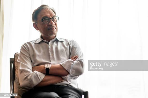 Anwar Ibrahim founder of Malaysia's People's Justice Party listens during an interview in Hong Kong China on Wednesday Sept 12 2018 Anwar whos in...