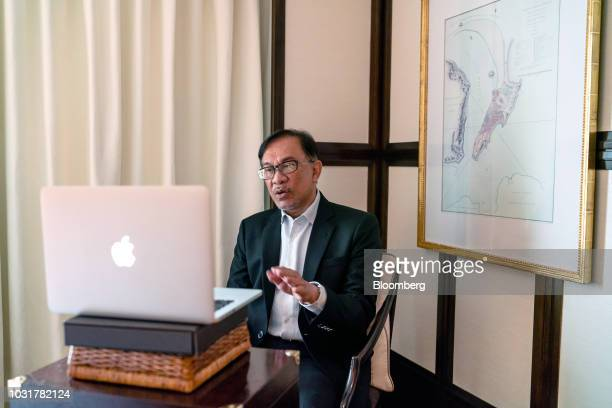 Anwar Ibrahim founder of Malaysia's People's Justice Party speaks into a laptop computer during a livestreaming interview in Hong Kong China on...
