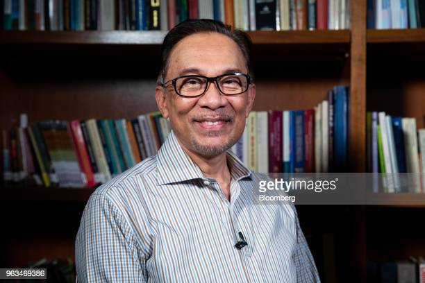Anwar Ibrahim founder of the People's Justice Party poses for a photograph following a Bloomberg Television interview in Kuala Lumpur Malaysia on...