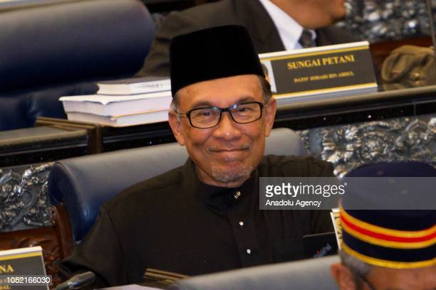 Anwar Ibrahim gestures after taking his oath as a Member of Parliament during the swearing in ceremony at Parliament House in Kuala Lumpur Malaysia...