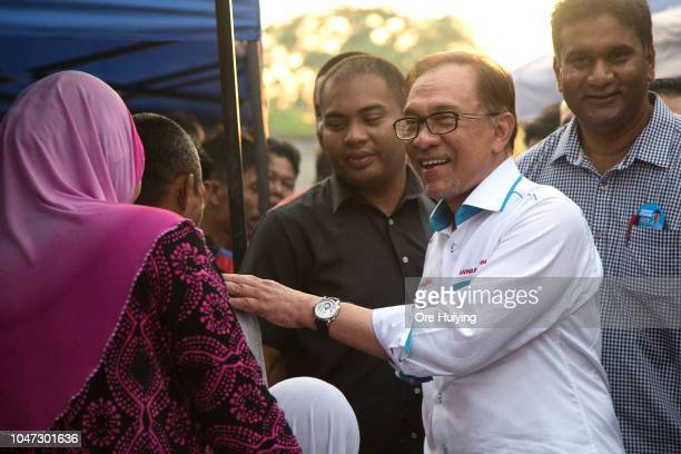 Anwar Ibrahim interacts with supporters during his byelection campaign rally on October 5 2018 in Port Dickson Malaysia Malaysia's prime...