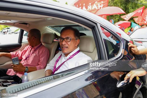 Anwar Ibrahim leader of the Pakatan Harapan Coalition arrives at a polling station for byelection in Port Dickson on October 13 2018 The Port Dickson...