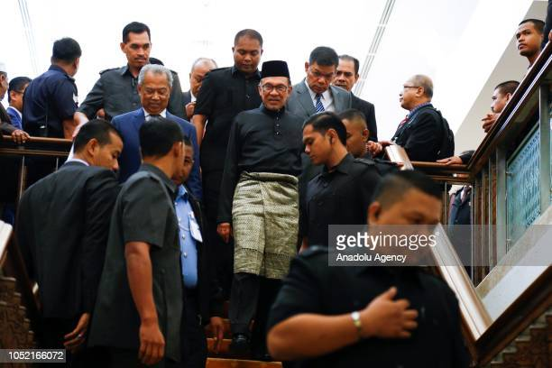 Anwar Ibrahim leaves House of Representatives after swearingin ceremony at the Parliament House in Kuala Lumpur Malaysia on October 15 2018 Anwar...
