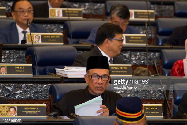 Anwar Ibrahim looks on after taking his oath as a Member of Parliament during the swearingin ceremony at the Parliament House in Kuala Lumpur...