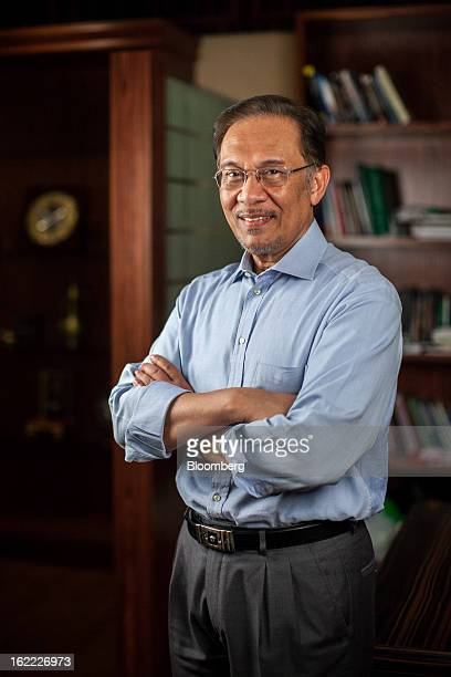 Anwar Ibrahim Malaysia's opposition leader poses for a photograph in Petaling Jaya Selangor Malaysia on Tuesday Feb 19 2013 Anwar who was jailed for...