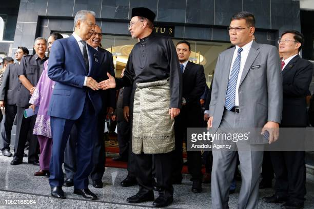 Anwar Ibrahim shakes hand with Muhyiddin Yassin Malaysia's Home Minister as he leaves House of Representatives after swearingin ceremony at the...