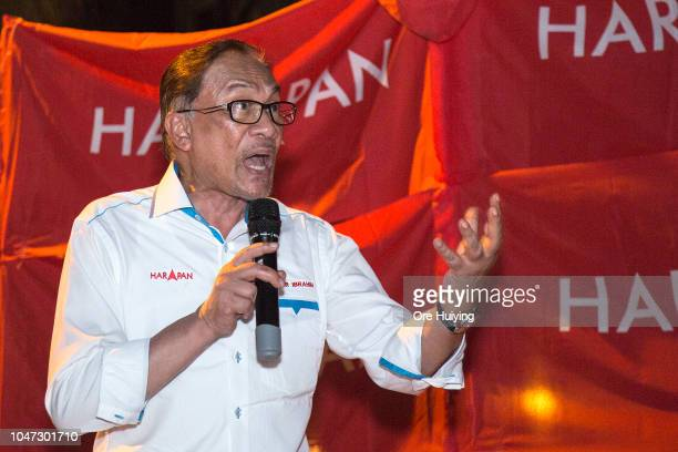 Anwar Ibrahim speaks to supporters during his byelection campaign rally on October 5 2018 in Port Dickson Malaysia Malaysia's prime ministerinwaiting...