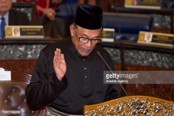 Anwar Ibrahim takes his oath as a Member of Parliament during the swearingin ceremony at the Parliament House in Kuala Lumpur Malaysia on October 15...