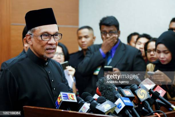 Anwar Ibrahim talks to media members during a press conference after swearingin ceremony at the Parliament House in Kuala Lumpur Malaysia on October...