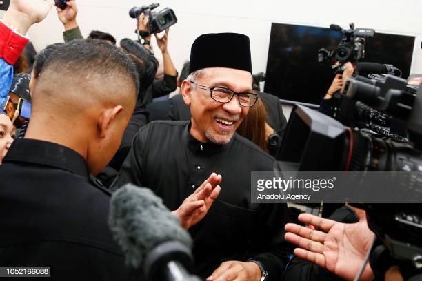 Anwar Ibrahim waves to media members after giving a press conference during swearingin ceremony at the Parliament House in Kuala Lumpur Malaysia on...