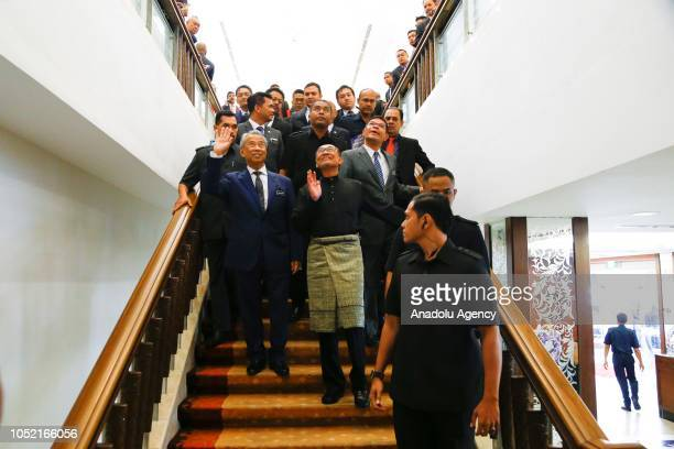 Anwar Ibrahim waves to media members as he leaves the House of Representatives after swearingin ceremony at the Parliament House in Kuala Lumpur...