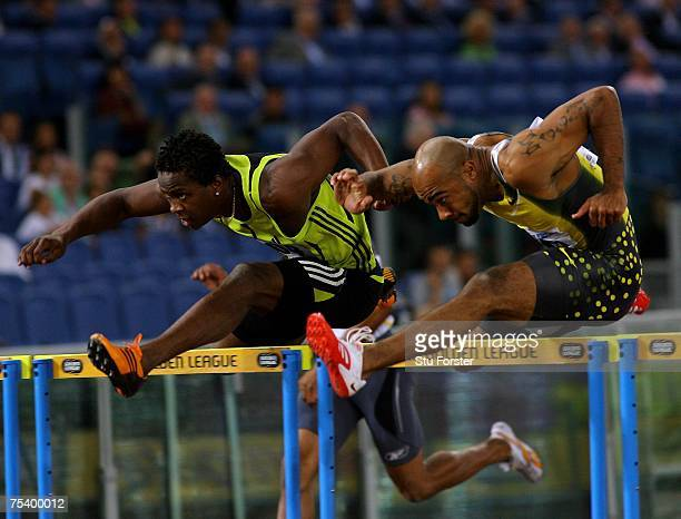 Anwar Moore of the USA clears the last hurdle ahead of Dayron Robles of Cuba before going on to win the Mens 110 metres Hurdles during the IAAF...