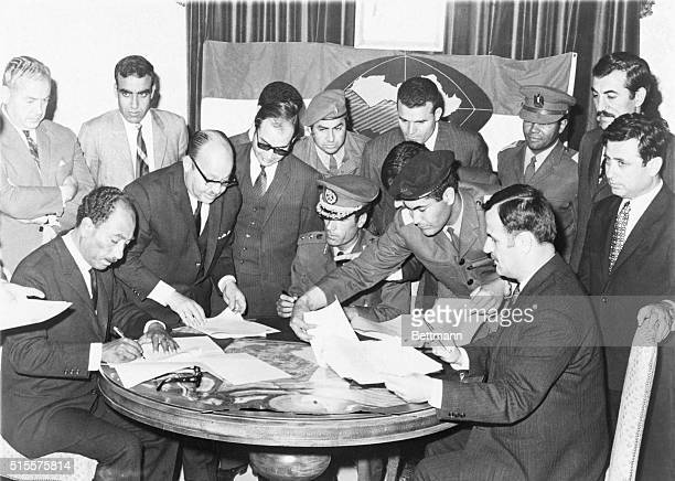 Anwar Sadat Muammar Khadafy and Hafez Assad the respective leaders of Egypt Libya and Syria sign an agreement establishing the Federation of Arab...