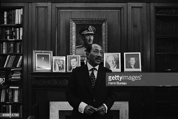 Anwar Sadat President of Egypt from 1970 to 1981 in his office in Cairo upon his return from Jerusalem Behind him are photographs of the Shah of Iran...