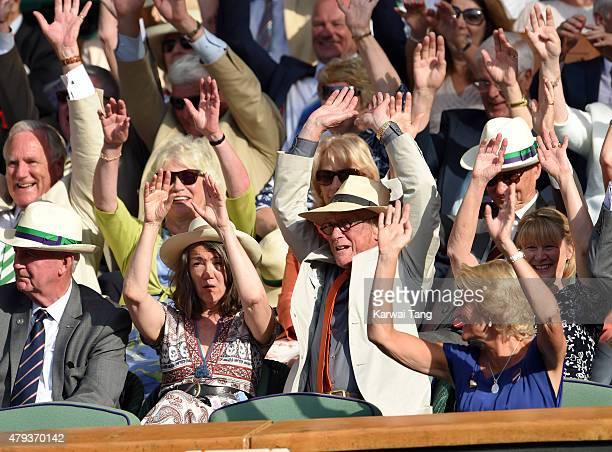 Anwen Rees-Myers and John Hurt attend the Serena Williams v Heather Watson match on day five of the annual Wimbledon Tennis Championships at...