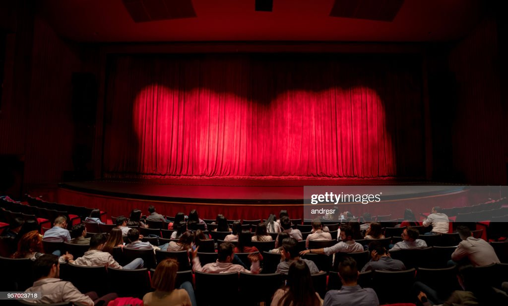 Anxious audience waiting for the curtains to open to see the performance : Stock Photo