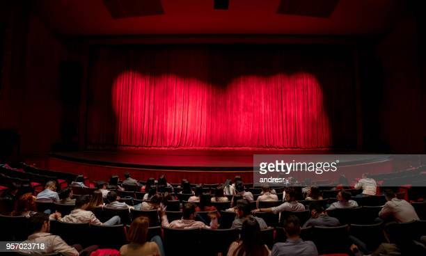 anxious audience waiting for the curtains to open to see the performance - performing arts event stock pictures, royalty-free photos & images