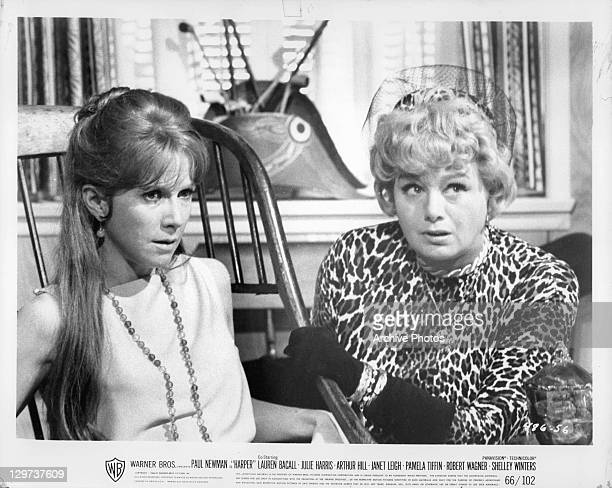 Anxious looking Julie Harris and Shelley Winters sitting in a scene from the film 'Harper' 1966
