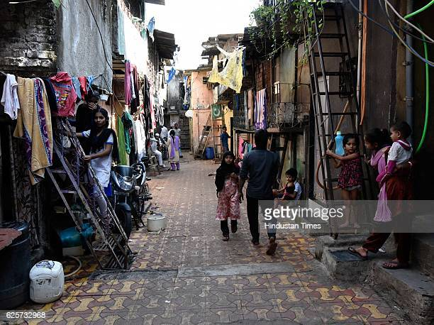 Anxious residents get ready to spend their last day in the slum in Dhobi Ghat as they will vacate their houses on November 24 2016 in Mumbai India...