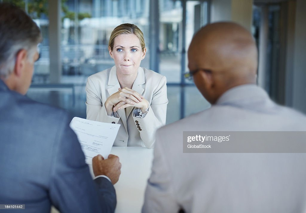 Anxious woman during business interview : Stock Photo