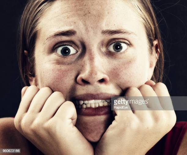 anxious young woman looks horrified - terrified stock pictures, royalty-free photos & images