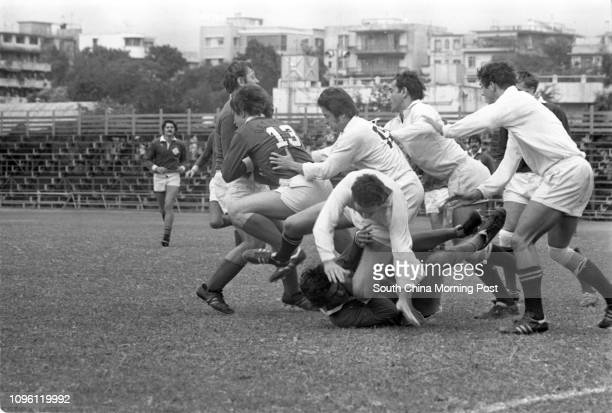 Any better word than 'confusion' to describe a rugby game Pictured at a match between the Police team and the visiting Sports Club Germania of...