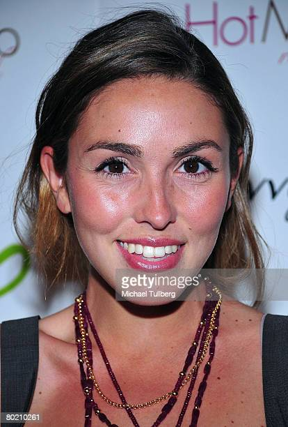 Anya Assante poses on the red carpet at the Hot Moms Club 'Super Community' launch party and fundraiser held at the Stone Rose Lounge on March 11...