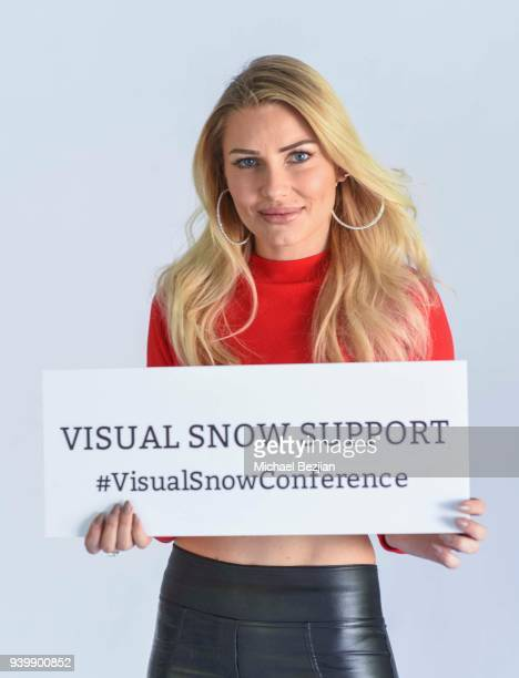 Anya Benton poses with Visual Snow Conference at The Artists Project Giveback Day on March 28 2018 in Los Angeles California