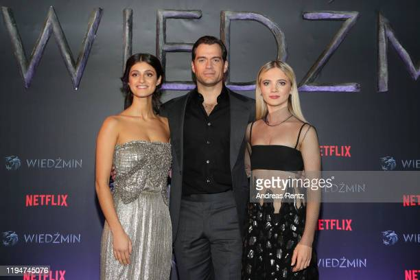 Anya Chalotra Henry Cavill and Freya Allan attend the premiere of the Netflix series The Witcher on December 18 2019 in Warsaw Poland