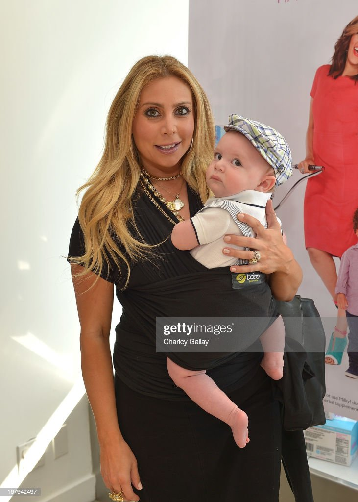 Anya Sarre and son Sawyer Sarre attend the Milky! launch event at A Pea In The Pod on May 2, 2013 in Beverly Hills, California.