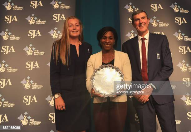Anya Shrubsole and England women coach Mark Robinson receive Sports Team of the Year award from Maggie Alphonsi during The SJA British Sports Awards...