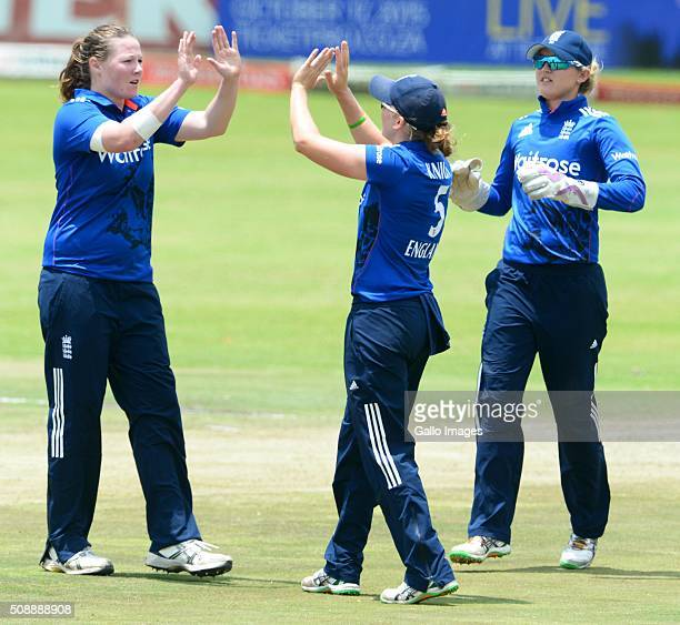 Anya Shrubsole and Heather Knight of England celebrate the wicket of Mignon du Preez of South Africa during the One Day International match between...