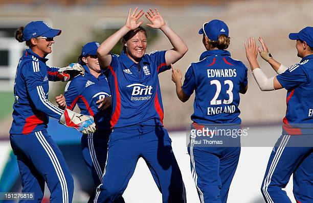 Anya Shrubsole of England celebrates with team mates after taking the wicket of England Academy's Amy Jones during the friendly T20 cricket match...