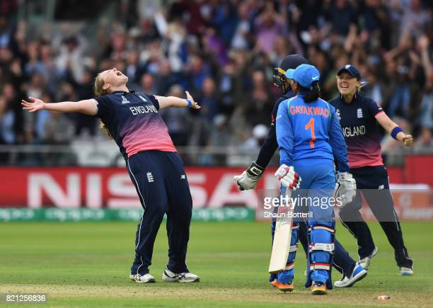 Anya Shrubsole of England celebrates with team-mates Sarah Taylor and Heather Knight after taking the final India wicket of Rajeshwari Gayakwad to...