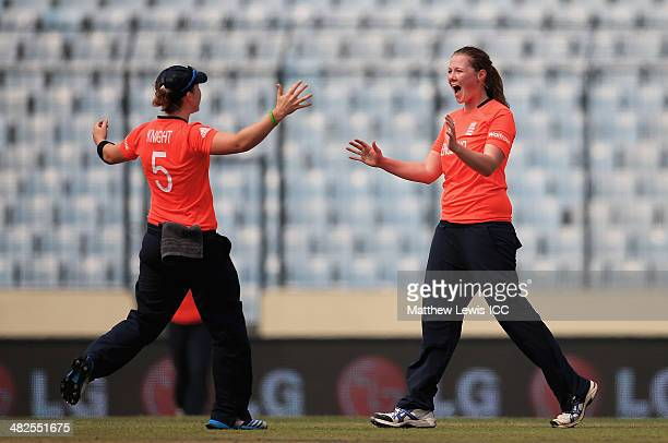 Anya Shrubsole of England is congratulated by Amy Jones after bowling Trisha Chetty of South Africa during the ICC World Twenty20 Bangladesh 2014...