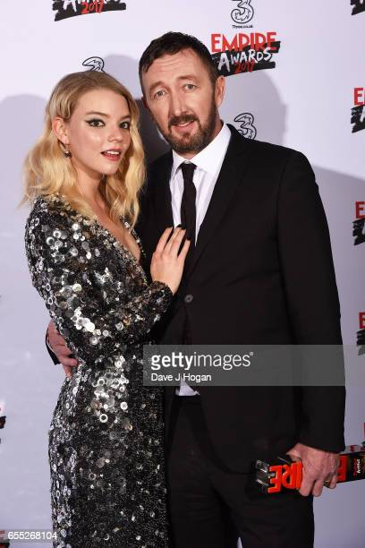 Anya TaylorJoy and Ralph Ineson pose with the award for Best Female Newcomer in the winners room at the THREE Empire awards at The Roundhouse on...