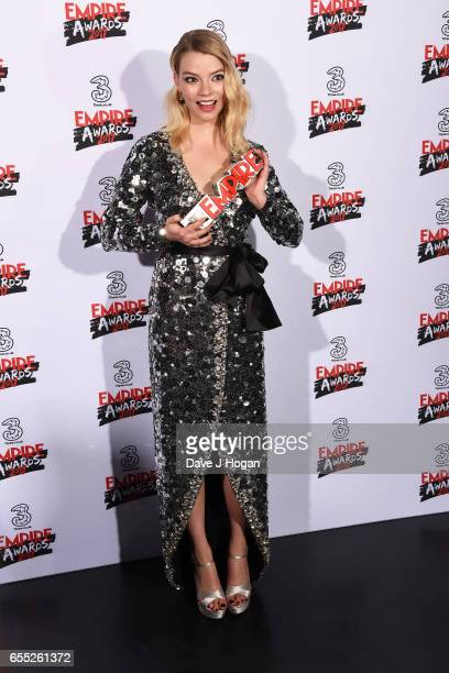 Anya TaylorJoy poses with the award for Best Female Newcomer in the winners room at the THREE Empire awards at The Roundhouse on March 19 2017 in...