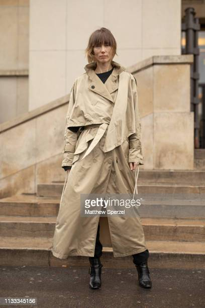 Anya Ziourova is seen on the street attending HAIDER ACKERMANN during Paris Fashion Week AW19 wearing taupe trench coat on March 02 2019 in Paris...