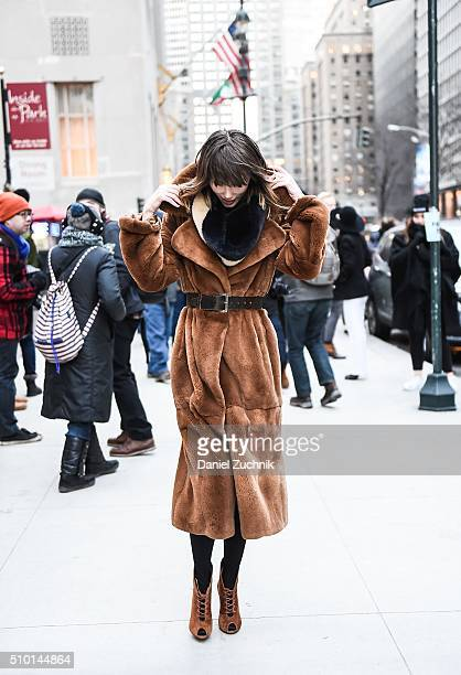 Anya Ziourova is seen outside the Alexander Wang show wearing a brown fur coat during New York Fashion Week: Women's Fall/Winter 2016 on February 13,...