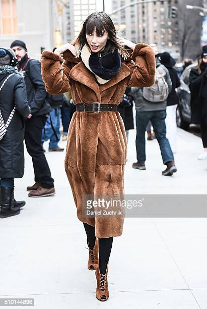 Anya Ziourova is seen outside the Alexander Wang show wearing a brown fur coat during New York Fashion Week Women's Fall/Winter 2016 on February 13...