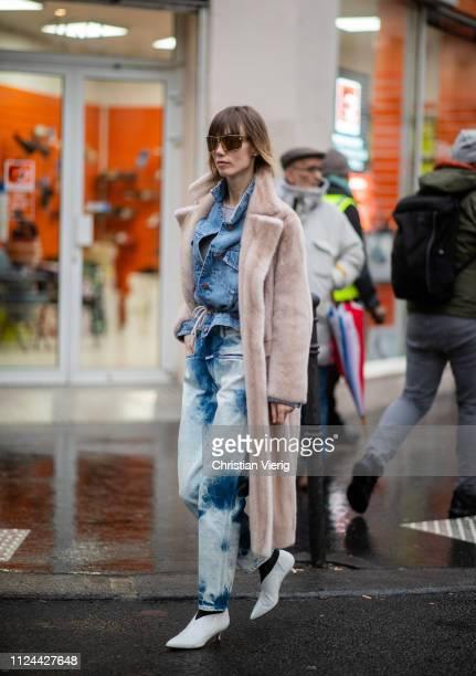 Anya Ziourova is seen wearing denim jacket janes white heels fake faux coat sunglasses outside Maison Margiela during Paris Fashion Week Haute...