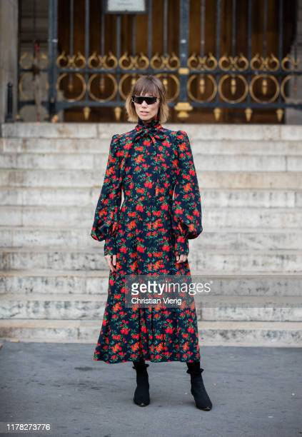 Anya Ziourova is seen wearing dress with long sleeves and floral print outside Stella McCartney during Paris Fashion Week Womenswear Spring Summer...