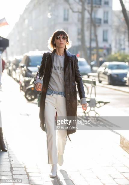Anya Ziourova seen wearing brown coat, two tone jeans, grey shirt outside Iris van Herpen during Paris Fashion Week - Haute Couture Spring/Summer...