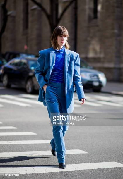Anya Ziourova wearing a blue suit velvet knit outside Marc Jacobs on February 16 2017 in New York City