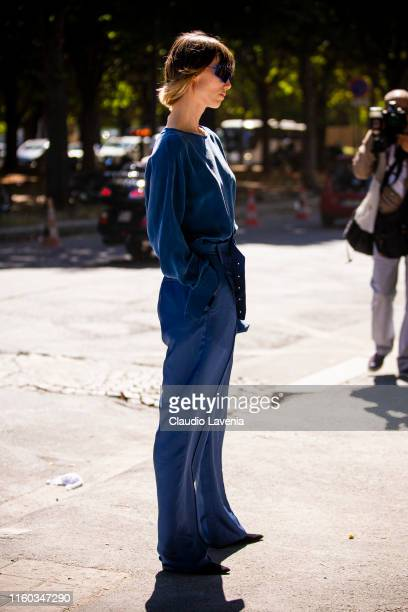 Anya Ziourova, wearing a blue top with matching pants and black heels, is seen outside Alexandre Vauthier show during Paris Fashion Week - Haute...