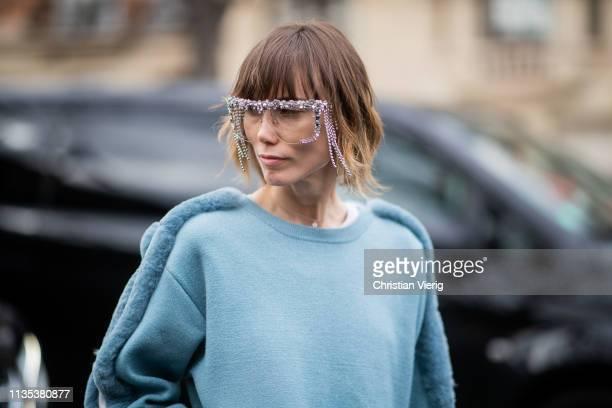 Anya Ziourova wearing glasses is seen outside Miu Miu during Paris Fashion Week Womenswear Fall/Winter 2019/2020 on March 05 2019 in Paris France