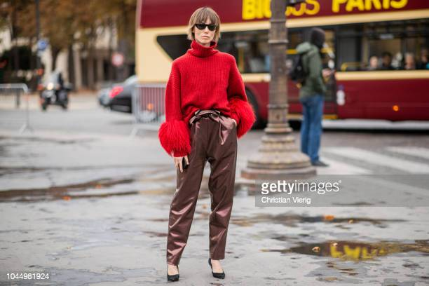 Anya Ziourova wearing red turtleneck knit high waist pants heels is seen outside Chanel during Paris Fashion Week Womenswear Spring/Summer 2019 on...